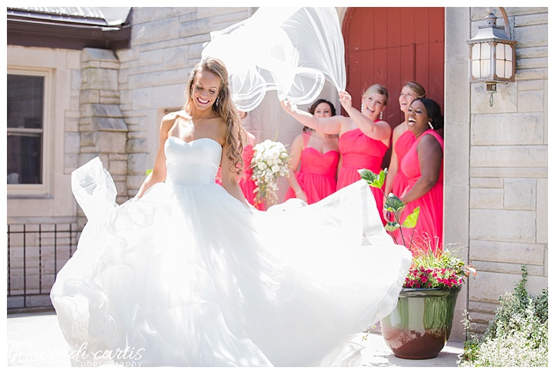 Bride twirling with bridesmaids